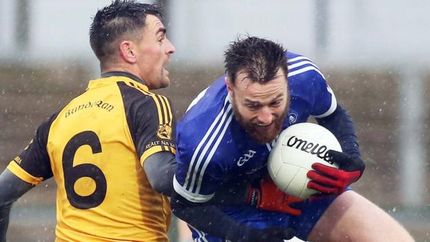 Bundoran defender Shane McGowan puts in a strong tackle on Loughinisland's Conor Megoran in the Intermediate final at Owenbeg