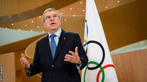 IOC president Thomas Bach addresses the media after a board meeting