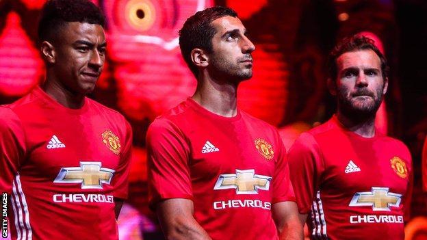 Jesse Lingard, Henrikh Mkhitaryan and Juan Mata model United's new kit
