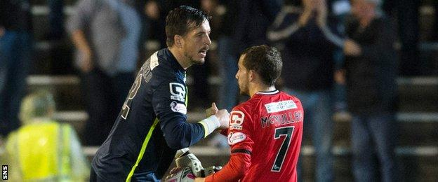 Jamie Langfield shakes hands with team-mate Paul McMullan