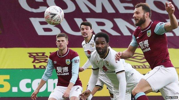 Cameron Jerome heads MK Dons in front against Burnley at Turf Moor