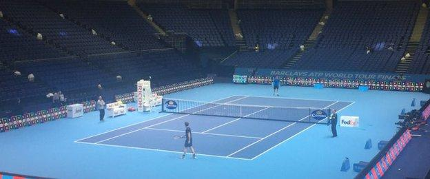 Andy Murray in front of a deserted O2 Arena