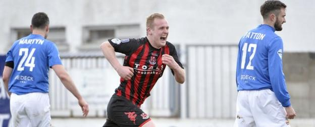 A delighted Jordan Owens runs away in celebration after scoring against Glenavon