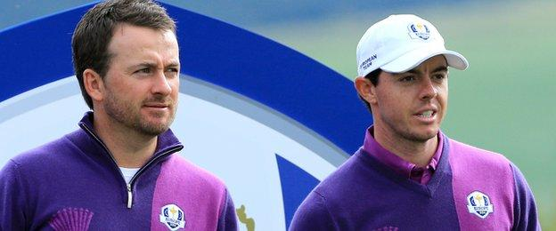 Graeme McDowell says the absence of injured Rory McIlroy from the Open is a 'massive blow'