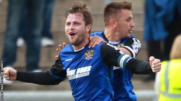 Stevenage defender Mark Hughes celebrates his late equaliser against Newport