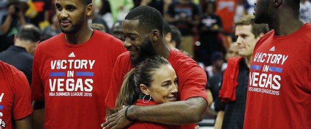 San Antonio Spurs coach Becky Hammon hugs Jonathan Simmons