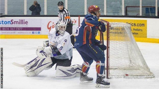 Edinburgh Capitals' Mike Cazzola tests Clan goalie Ryan Nie in Sunday's game
