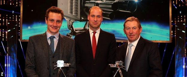 Alistair Brownlee, left, and Nick Skelton, right, celebrate coming second and third respectively with HRH The Duke of Cambridge