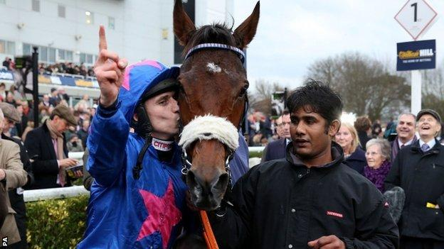 Paddy Brennan celebrates victory on Cue Card
