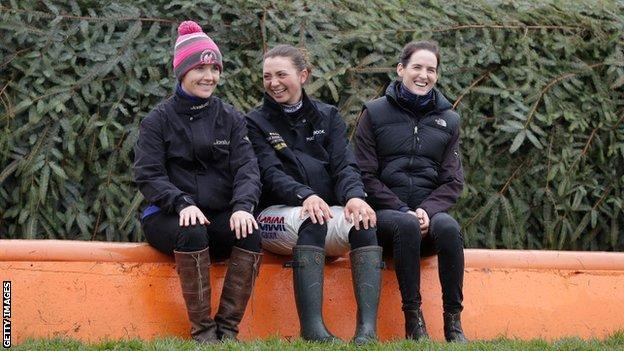 Katie Walsh, now retired as a jockey, shares a joke with Bryony Frost and Rachael Blackmore at Aintree
