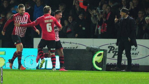 Paul Tisdale reacts to Lee Holmes after he put Exeter 2-1 up against Liverpool at St James Park