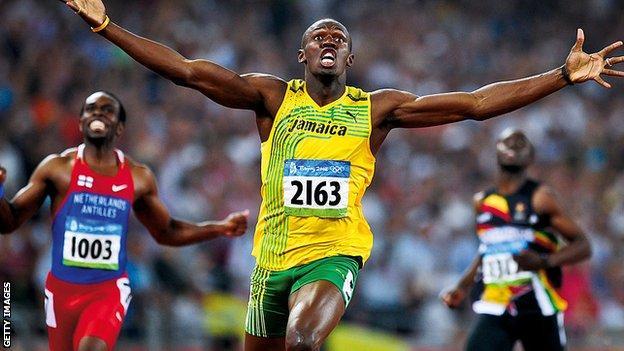 Usain Bolt celebrates gold at the Beijing Olympics