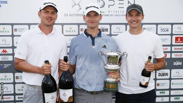 Nicolai Hojgaard (centre) his brother Ramus Hojgaard (right) and his caddie Christian Baeck (left)