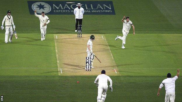 Craig Overton celebrates his first Test wicket