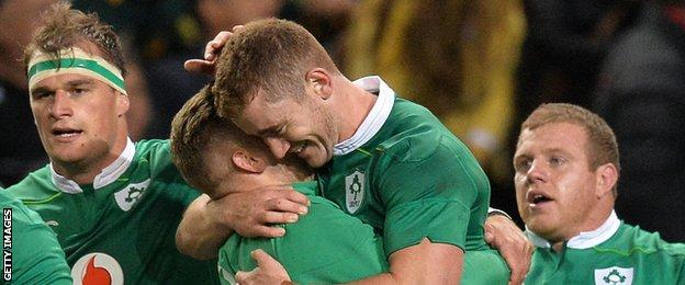Paddy Jackson is embraced by Ian Madigan after Ireland's win in Cape Town