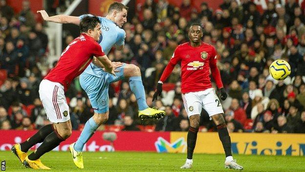 Burnley's Chris Wood volleys past Manchester United's David de Gea