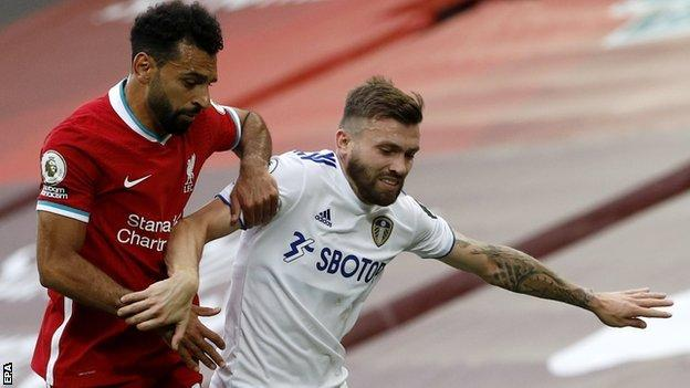 Leeds United full-back Stuart Dallas in action against Liverpool forward Mohamed Salah