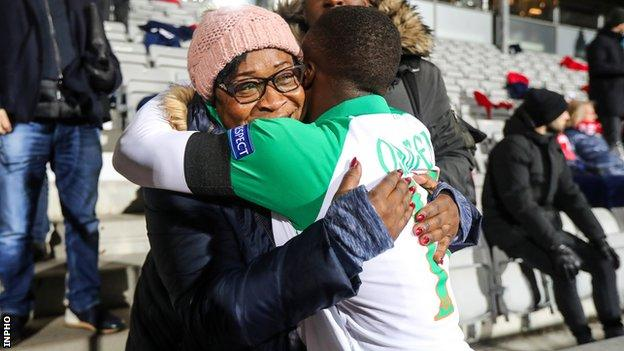 Michael Obafemi and his mother Bola