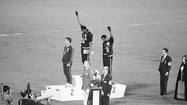 Tommie Smith and John Carlos raise their fist in a Black Power salute on the podium at the Olympics