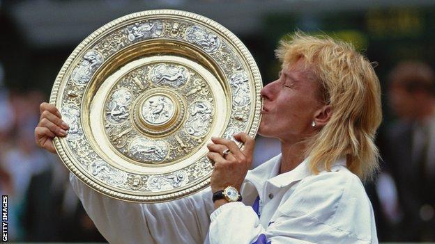 Martina Navratilova celebrates with the Venus Rosewater Dish after winning Wimbledon in 1990