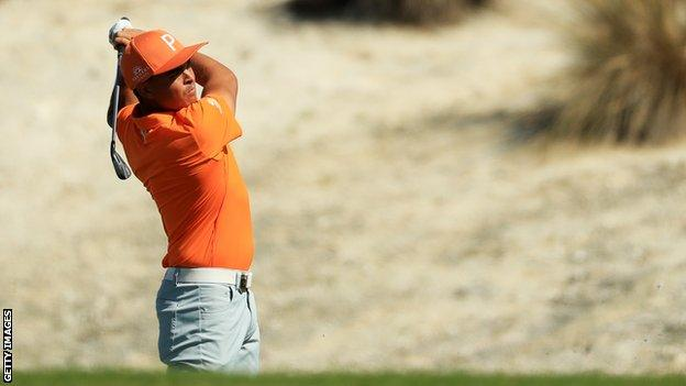 Rickie Fowler plays a shot at the Hero World Challenge