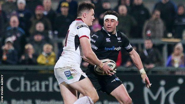 Ulster's Jacob Stockdale with Ospreys' Kieron Fonotia