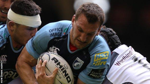 Sam Warburton is tackled by Ospreys prop Nicky Smith