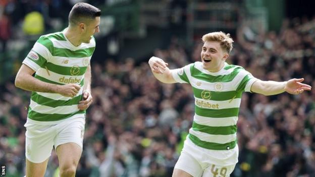 Celtic's Tom Rogic and James Forrest celebrate against Rangers