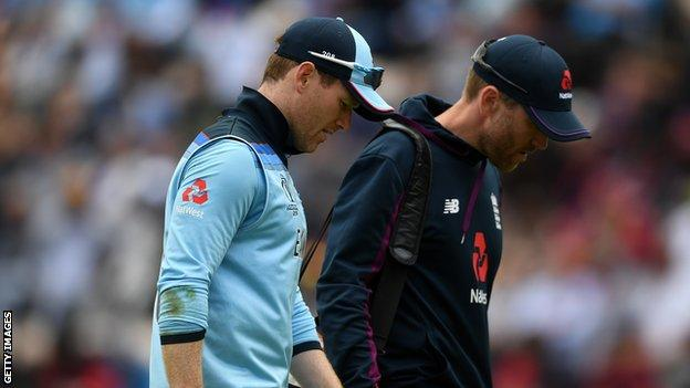 England captain Eoin Morgan walks off the field with a back injury against West Indies