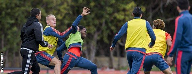 Miquel Nelom fights with Tonny Vilhena as other Feyenoord players and staff look on