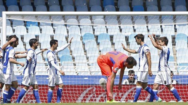 Real Sociedad celebrate scoring against Granada