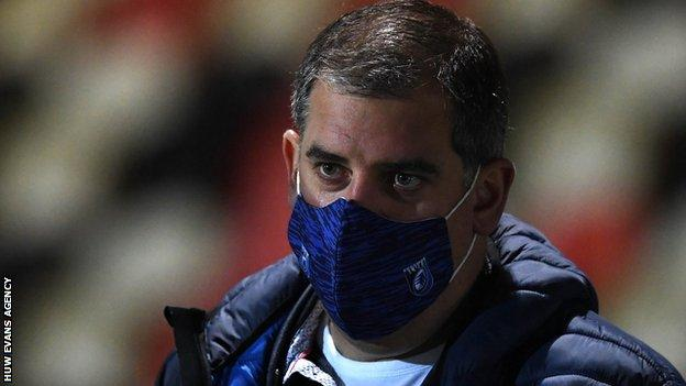 Richard Holland wears a mask at a Cardiff Blues game
