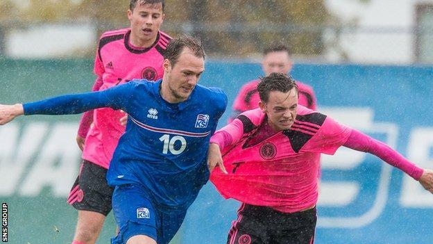 Scotland's Aidan Nesbitt (right) and Aron Elis Thrandarson