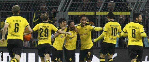 Borussia Dortmund players celebrate a goal against Stuttgart