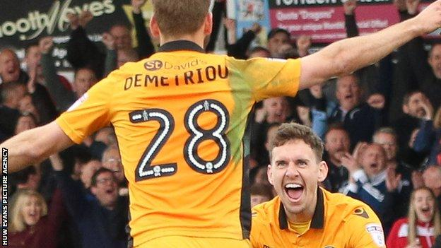 Newport scorer Mickey Demetriou spins away to celebrate with man of the match Mark Randall
