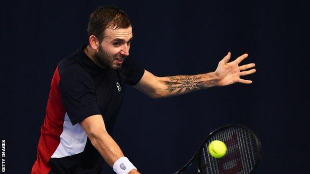Dan EVans playing at the Battle of the Brits event