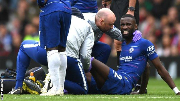 Antonio Rudiger receiving treatment on the pitch at Manchester United on Sunday
