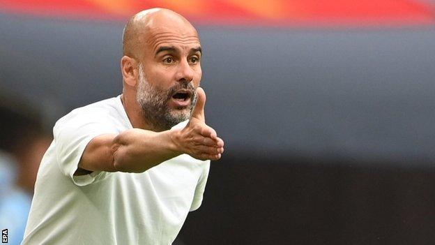 Manchester City'ss manager Pep Guardiola on the directing his player from the sideline