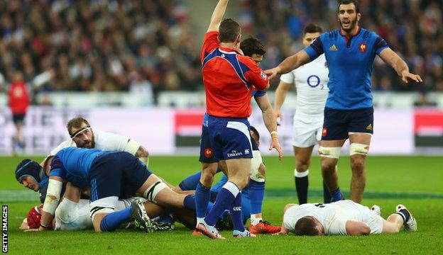 Dylan Hartley lies on the floor after the clash with Atonio