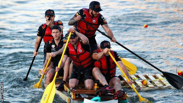 The Red Bull Racing team compete in the raft race