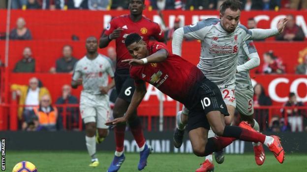 Xherdan Shaqiri fouls Marcus Rashford