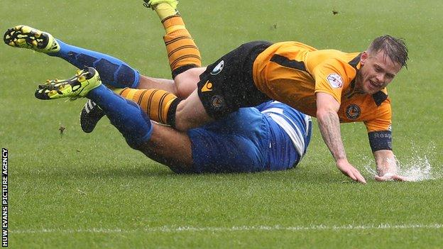 Mark Byrne of Newport County is tackled by Cole Kpekawa of Queens Park Rangers