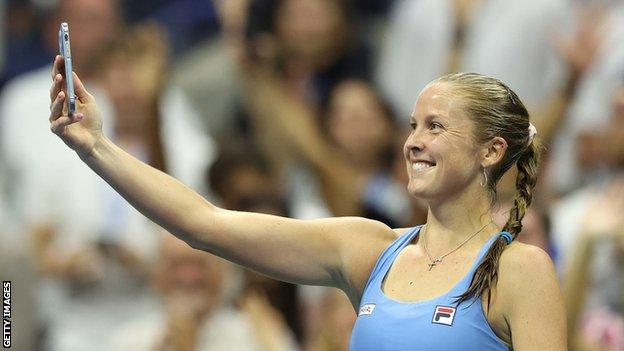 Shelby Rogers takes a selfie on court after beating Ash Barty