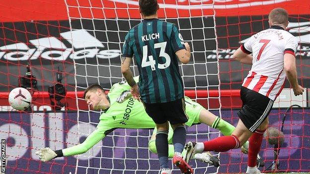 Illan Meslier saves from John Lundstram