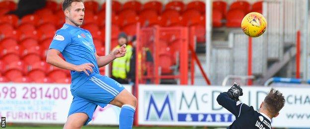 Greg Stewart watches as his shot beats Gary Woods to draw Aberdeen level in the first half