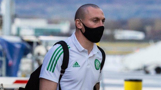 Celtic captain Scott Brown at Glasgow Airport