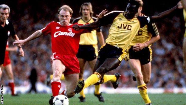 Arsenal's Michael Thomas tackles Liverpool's Steve McMahon