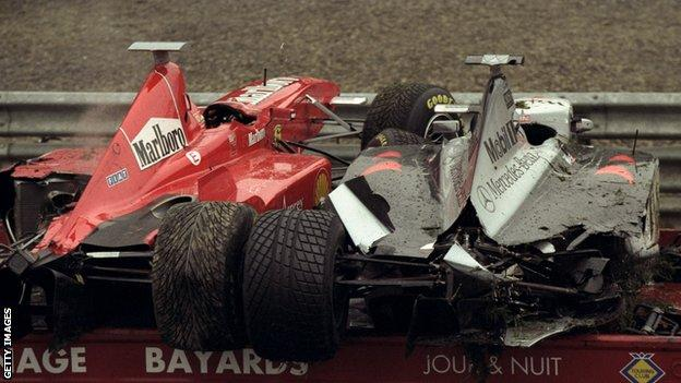 Eddie Irvine and David Coulthard's cars are loaded onto the recovery van