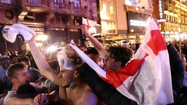English fans celebrate victory over Ukraine in Leicester Square in London
