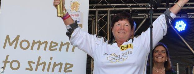 Sally Minty-Gravett with Olympic torch